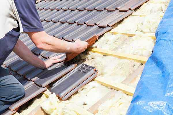 re-roofing winter setting roof tiles