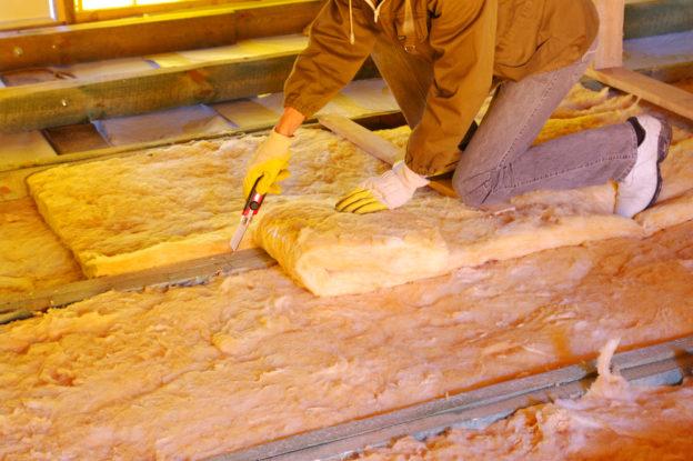 attic insulation being cut an dinstalled
