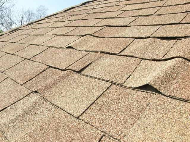 roof with shingles buckling